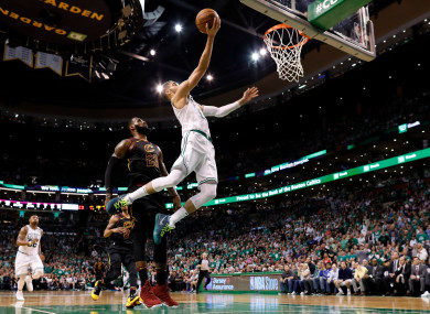Jayson Tatum attempts a layup in front of LeBron James during the third quarter of game five.