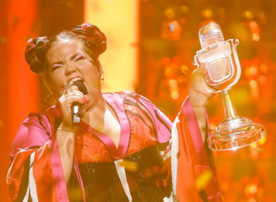 Israel's Netta performs Toy, holding her trophy at the 63rd Eurovision Song Contest.