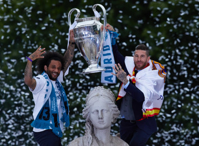 Real Madrid parade Champions League trophy in front of thousands of  ecstatic fans ad9f18016a2fd