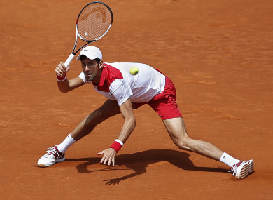 Djokovic returns the ball to Edmund in the second round clash.