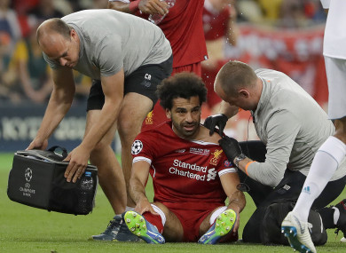 Liverpool's Mohamed Salah gets medical treatment during the Champions League Final.