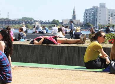 People sunbathing at the Grand Canal Dock area today.