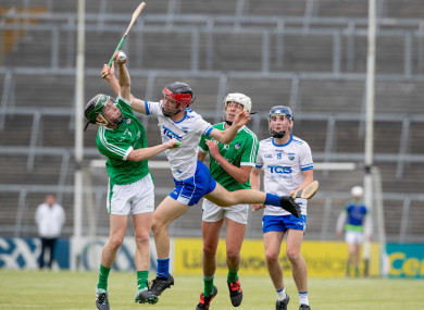 Limerick's Barry O'Connor and Diarmuid Hegarty with Ryan Tierney and James Power of Waterford.