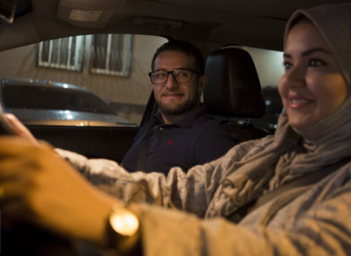 Walaa Abou Najem, with her husband Ammar Akelah, as she drives her car for the first time through the capital's streets early this morning.