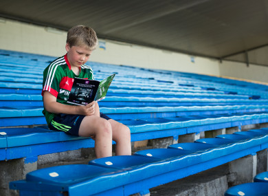 John O'Neill reads a match programme before Mayo's clash in Thurles.