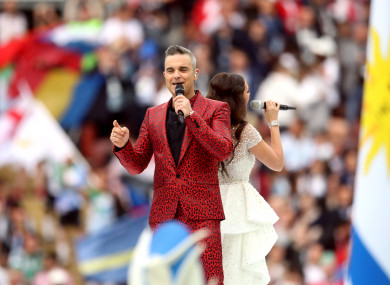 Robbie Williams performs at the opening ceremony.