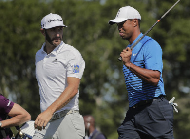 Dustin Johnson and Tiger Woods during a practice round on Tuesday.