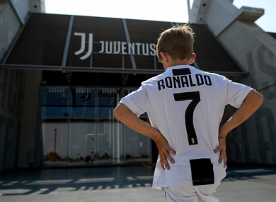 9fff761c3 A young Juve supporter poses outside the Allianz Stadium wearing a Ronaldo  shirt.