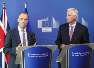 New British Government Brexit secretary Dominic Raab (left) is welcomed by EU's chief Brexit negotiator Michel Barnier ahead of a meeting at the European Commission