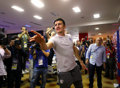 England's Harry Maguire plays darts with the media during the World Cup.