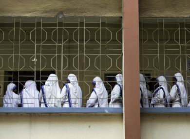 Nuns of Missionaries of Charity, the order founded by Mother Teresa, stand in a queue to cast their vote in Kolkata, India (April 2011).