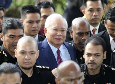 Former Malaysian prime minister Najib Razak (centre) arrives at court in Kuala Lumpur