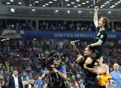 Luka Modric celebrates Croatia's victory over Russia.
