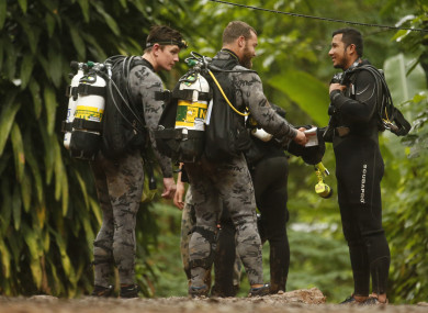 Australian Federal Police and Defence Force personnel talks to Thai rescue before diving.