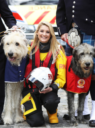 Laura Jackson from Royal National Lifeboat Institution with Darcy aged 2 from the ambulance service (L) and Seodin aged 2 from Dublin fire brigade (R)