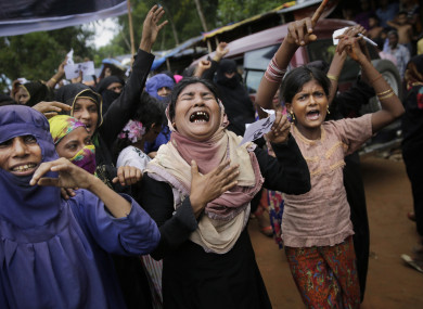 Rohingya women cry as they shout slogans during a protest rally to commemorate the first anniversary of Myanmar army's crackdown.