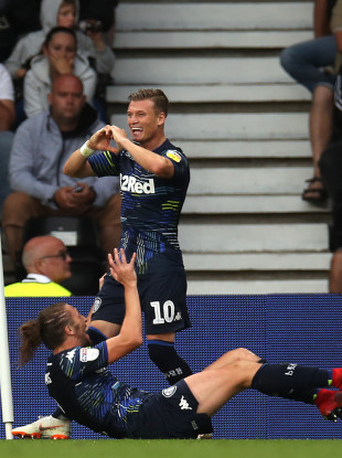 Leeds United's Ezgjan Alioski (centre) celebrates scoring his side's fourth goal of the game.