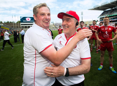 Tyrone's Gavin Devlin celebrates with manager Mickey Harte after the game.