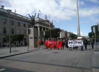 A group of housing protesters travel along O'Connell Street