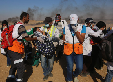 Medical staff carry an injured girl during clashes on Gaza-Israel border, east of the southern Gaza Strip City of Khan Younis.