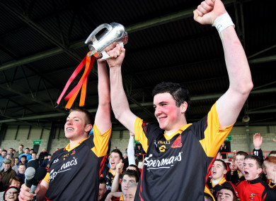 Shane Dowling and Declan Hannon lift the Dr Harty Cup in 2011.