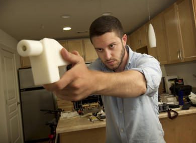 Cody Wilson shows the first completely 3D-printed handgun called The Liberator.