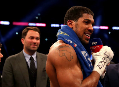 Anthony Joshua speaking after last night's win at Wembley, as Eddie Hearn looks on.