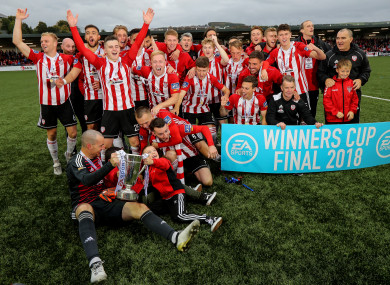 Derry City players celebrate with the trophy.