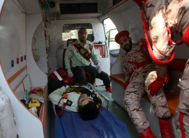 Wounded military personnel in an ambulance after today's shooting.