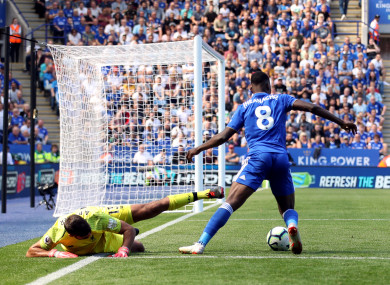 Leicester City's Kelechi Iheanacho wins the ball off Liverpool goalkeeper Alisson.