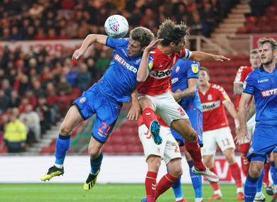 Middlesbrough's George Friend (right) and Bolton Wanderers' Joe Williams during tonight's game at the Riverside Stadium.