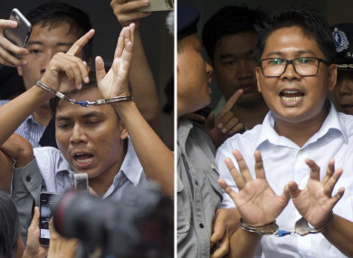 Reuters journalists Kyaw Soe Oo, left, and Wa Lone, are handcuffed as they are escorted by police out of the court today.