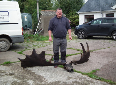 Raymond McElroy pictured with the skull and antlers.