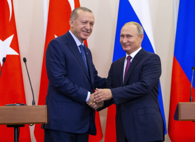 Russian President Vladimir Putin and Turkish President Recep Tayyip Erdogan shake hands after their joint news conference today