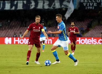 Arkadiusz Milik with Liverpool captain Jordan Henderson last night.