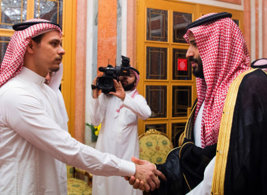Saudi Crown Prince Mohammed bin Salman, right, shakes hands with Salah Khashoggi (victim's son) after they received him in Riyadh, Saudi Arabia.