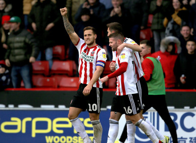 Sheffield United's Billy Sharp (left) celebrates after he scores his sides fourth goal.