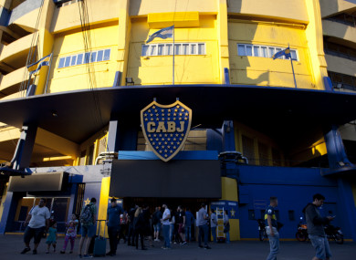 People stand outside Boca Juniors stadium in Buenos Aires.