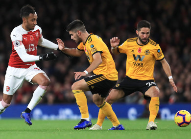 Arsenal's Pierre-Emerick Aubameyang, with Wolves pair Ruben Neves and Joao Moutinho.
