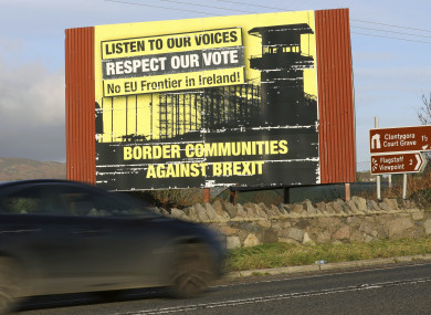 A motorist makes their way North along the old Belfast to Dublin road on the Irish border.