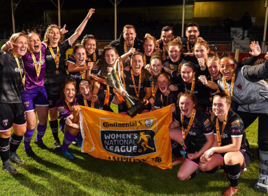 Elmes (centre) helped lead Wexford Youths to the Women's National League this year.