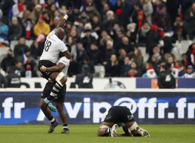 Fiji celebrate a famous win.