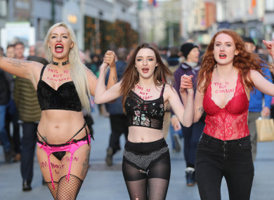 Protestors Stacie Ellen Murphy, Alanna Cassidy and Lena Seale walk in their underwear along Grafton Street, Dublin, in support of victims of sexual violence.