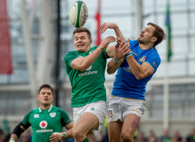 Italy's Mattia Bellini battles for possession with Ireland's Jacob Stockdale during the 2018 Six Nations fixture in Dublin.