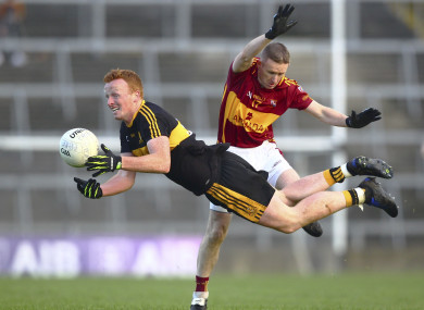 Dr Crokes Johnny Buckley tackled by Miltown-Malbay's Eoin Curtin.