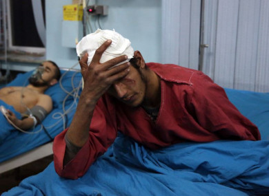 Injured men at a hospital after a suicide bombing in Kabul, Afghanistan.
