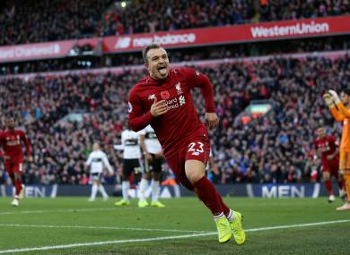 Xherdan Shaqiri celebrates making it 2-0 at Anfield on Sunday afternoon.