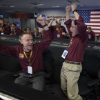 Mars InSight team members Kris Bruvold, left, and Sandy Krasner react after receiving confirmation that the Mars InSight lander successfully touched down on the surface in November. <span class=
