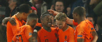 Netherlands players celebrate scoring.