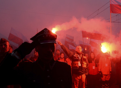 Marchers burn flares during the annual March of Independence organized by far right activists.